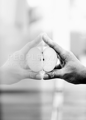 Buy stock photo A hand pressing quarter of an apple against a window with it's refection in the glass