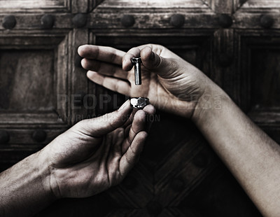 Buy stock photo Closeup of two hands holding a nut and bolt against a wooden door