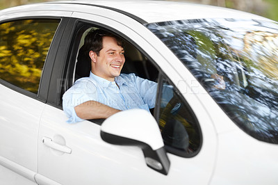 Buy stock photo A man happily driving his car