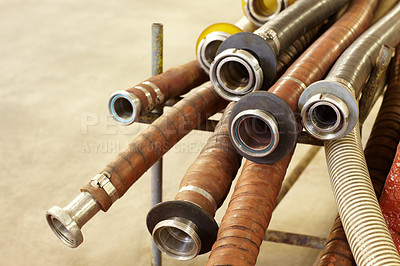 Buy stock photo Shot of unused hoses in a wine factory