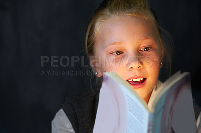 Buy stock photo A cute blonde girl reading a book in class