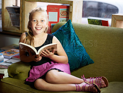 Buy stock photo Portrait of a cute blonde girl relaxed and reading on the couch