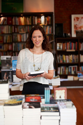 Buy stock photo Portrait of a smiling woman browsing in a bookstore