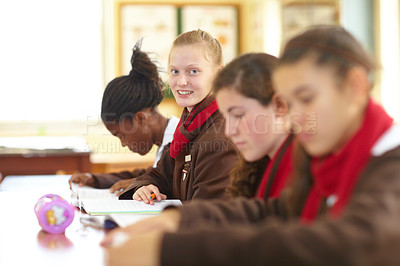 Buy stock photo Row of high school students sitting in the classroom