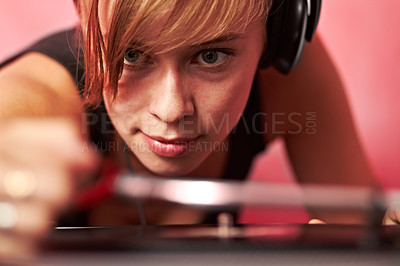 Buy stock photo Closeup of a young female dj putting on a record