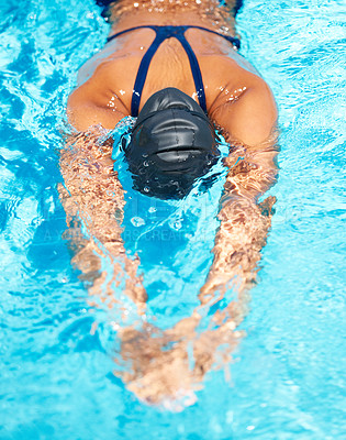Buy stock photo High-angle view of a female swimmer gliding through the pool
