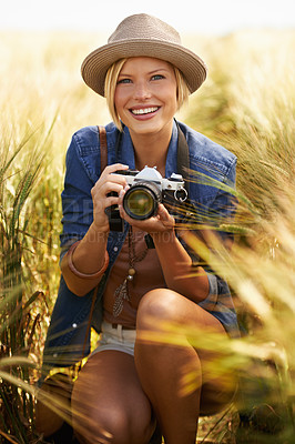Buy stock photo Portrait of an attractive young woman holding a camera