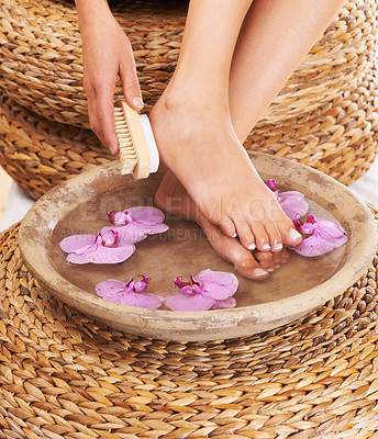Buy stock photo Closeup of a woman scrubbing her feet