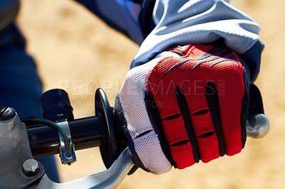 Buy stock photo Closeup of a dirt biker's hand wearing a glove