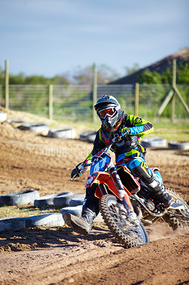 Buy stock photo A motocross rider skidding down the track