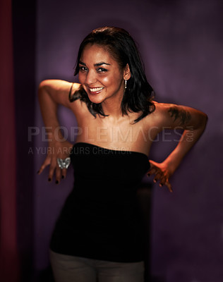 Buy stock photo Portrait of a tipsy girl about to pull her top down while dancing in the blub