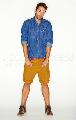 Buy stock photo Stylish young guy against a white background with his hands in his pockets