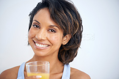 Buy stock photo A beautiful young woman about to enjoy a glass of fresh orange juice
