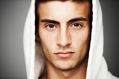 Buy stock photo Portrait of a good looking male with a hoodie on