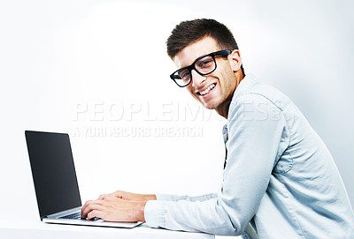 Buy stock photo A smiling hipster working on his laptop