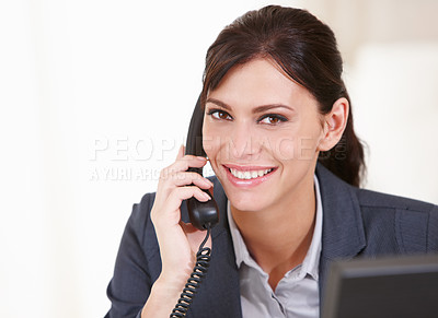 Buy stock photo Close up portrait of an attractive businesswoman talking on a phone