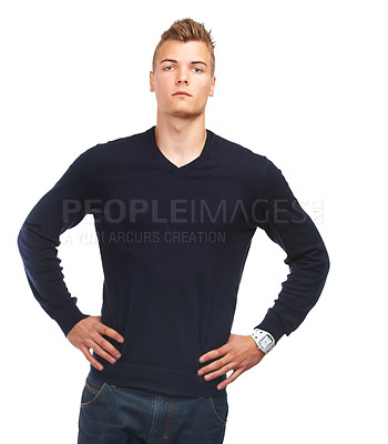 Buy stock photo Studio portrait of a young guy standing with his hands on his hips against a white background