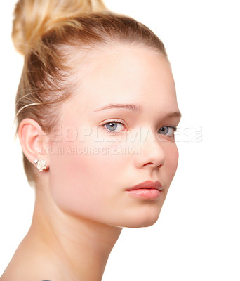 Buy stock photo Cropped portrait of a pretty young woman looking at the camera