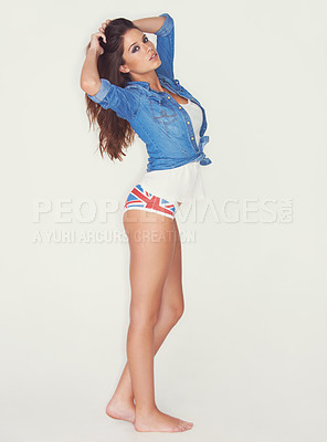 Buy stock photo Full length studio shot of an attractive young woman posing sideways for the camera