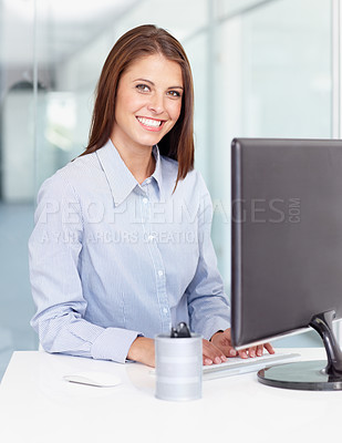 Buy stock photo A young professional sitting behind her computer