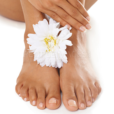 Buy stock photo Studio shot of a young woman's feet with a flower isolated on white