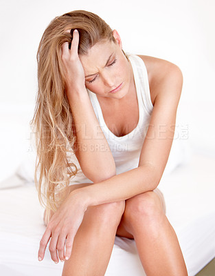Buy stock photo An exhausted young woman struggling to wake up in the morning