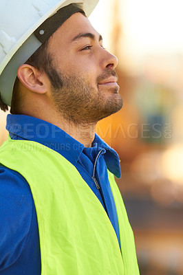 Buy stock photo A handsome engineer looking away thoughtfully