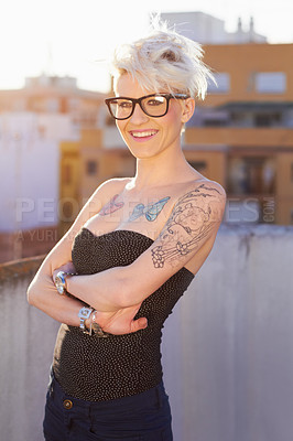 Buy stock photo Shot of a young woman with tattoos