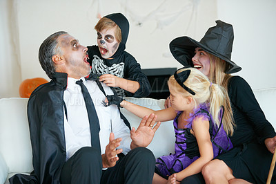 Buy stock photo A cute family dressed up for Hallowe'en all trying to scare each other