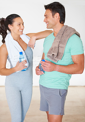 Buy stock photo Two young people talking to each other at the gym