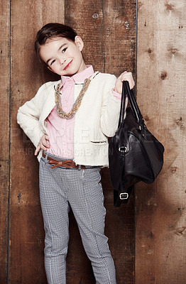 Buy stock photo Portrait of an adorable little girl dressed fashionably with a handbag