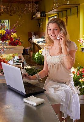 Buy stock photo Shot of a young florist at work in a flower shop
