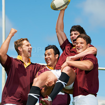 Buy stock photo Cropped shot of a young rugby team celebrating a victory
