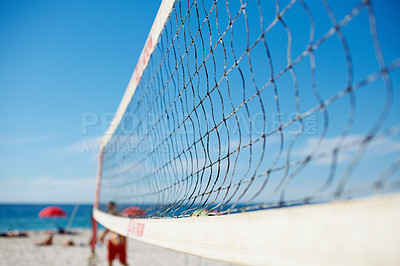 Buy stock photo Shot of a volleyball net on a beach
