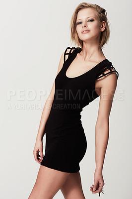 Buy stock photo An edgy fashion model standing alongside copyspace