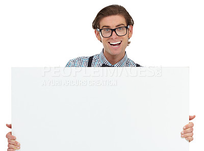 Buy stock photo A happy young man proudly holding up a blank placard for your ad