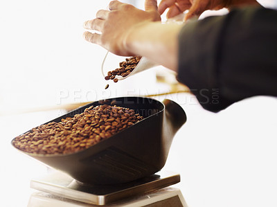 Buy stock photo Cropped shot of a barista carefully weighing some ground coffee