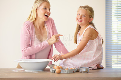 Buy stock photo Portrait of a little girl sitting on a kitchen counter with flour on her nose