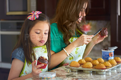 Buy stock photo Cute little girl baking with her nanny at home