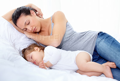 Buy stock photo A mother and daughter asleep in the bedroom