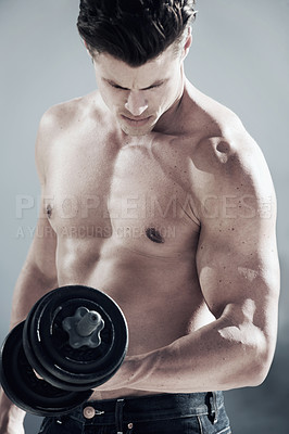 Buy stock photo A masculine male with no shirt on lifting weights