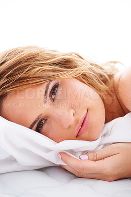 Buy stock photo Portrait of a woman lying in her bed hugging her sheet