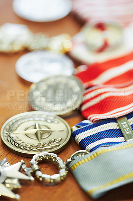 Buy stock photo Closeup shot of war medals lying on a table