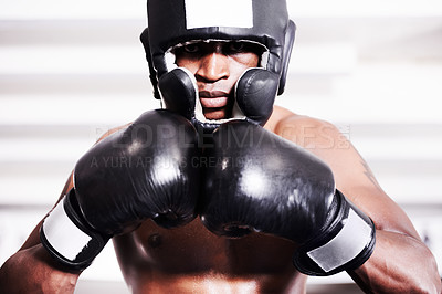Buy stock photo An african american boxer wearing protective gear standing in the ring
