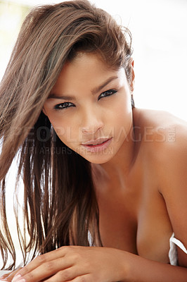 Buy stock photo Closeup of a sexy young ethnic woman looking at the camera