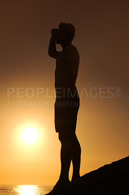 Buy stock photo Silhouette of a man looking over the ocean - profile