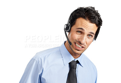 Buy stock photo A handsome customer service agent wearing a headset talking on the phone