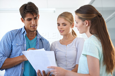 Buy stock photo Three young colleagues working in the office