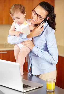 Buy stock photo Shot of a frustrated-looking single mom feeding her baby while trying to talk on the phone