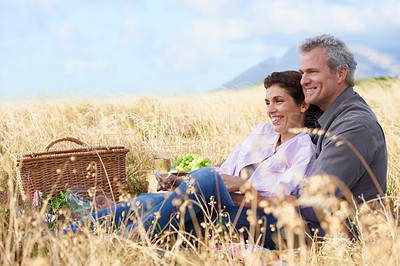 Buy stock photo A happy mature couple with their heads together affectionately